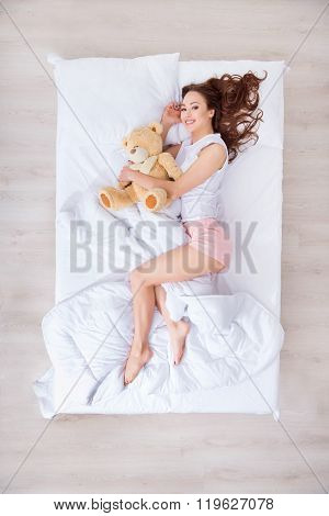 Charming woman lying in bed