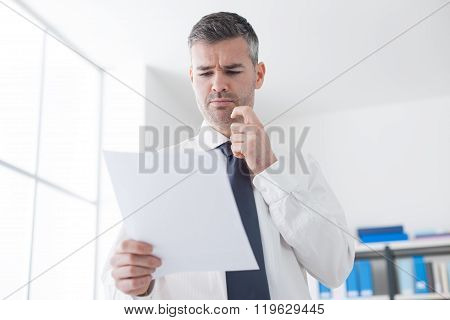 Businessman Examining Bills