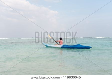 Woman Paddling On Stand Up Paddle Board