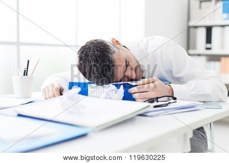 Manager Sleeping On His Desk