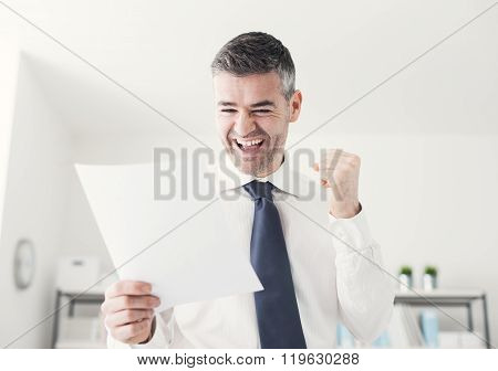 Cheerful Businessman Receiving Good News