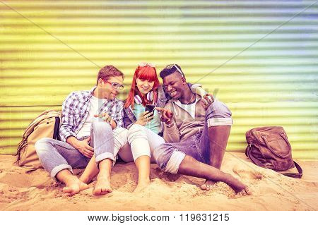Group Of Happy Multiracial Friends Having Fun Together Using Mobile Phone - Young Hipster People