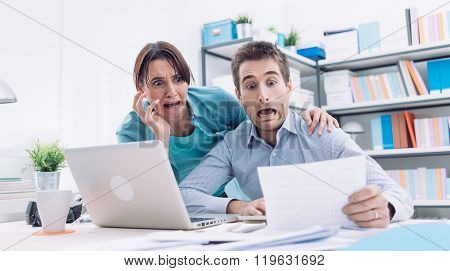 Stressed Couple Checking Bills