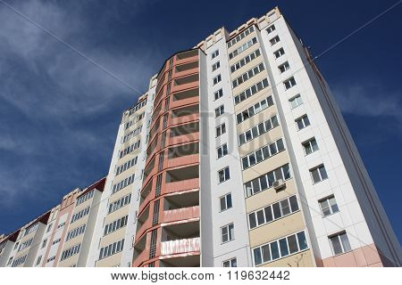 The inhabited high house against the blue sky