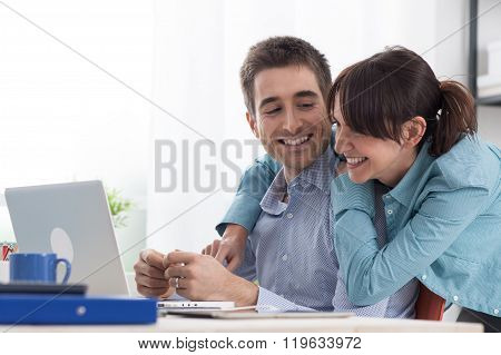 Young Couple Surfing The Web At Home