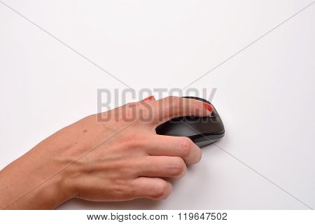 Close-up Of A Women Hand Using Modern Computer Mouse On White Surface