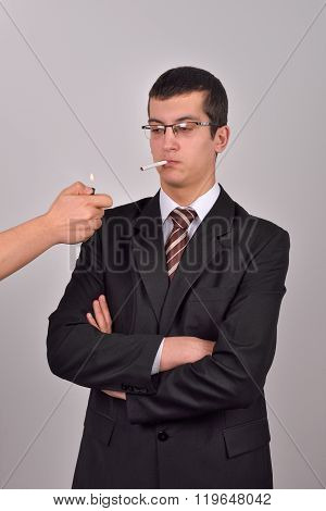Young Business Man Dressed In Tuxedo Is Whaiting For Somebody Else To Light His Cigarette