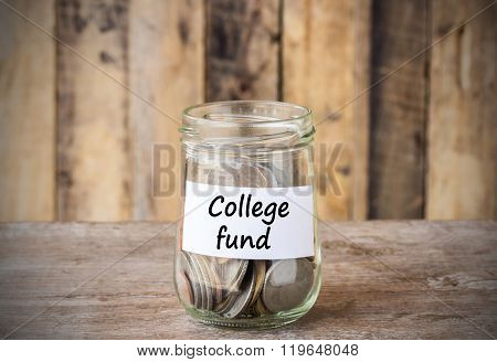 Coins In Glass Money Jar With College Fund Label, Financial Concept.