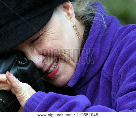 Mature female photographer.