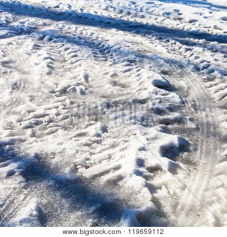 Frozen Car Traces On Snowy Country Road