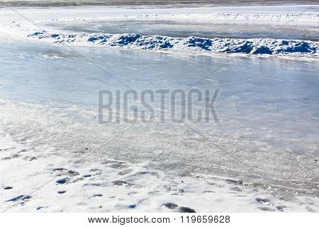 Frozen River In Sunny Winter Day