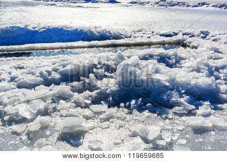 Broken Ice Near Hole In Frozen Lake