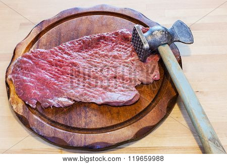 Meat Mallet And Beaten Piece Of Veal