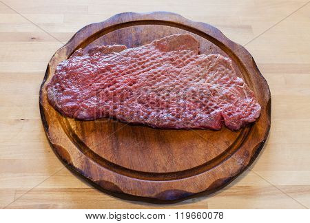 Beaten Slice Of Veal On Cutting Board