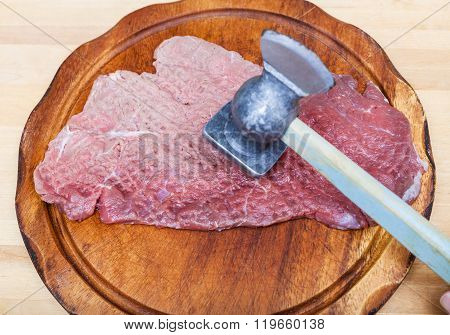 Piece Of Veal Is Beating By Meat Mallet