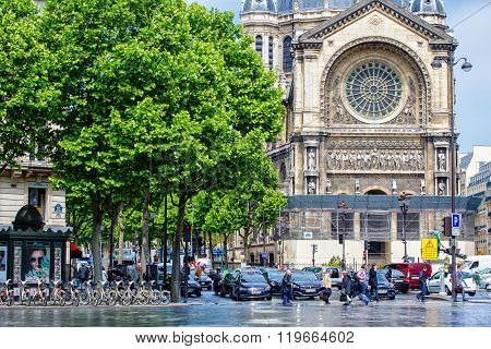 Lively square in front of Saint-Augustin church, Paris