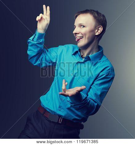 crazy man, against dark grey studio background