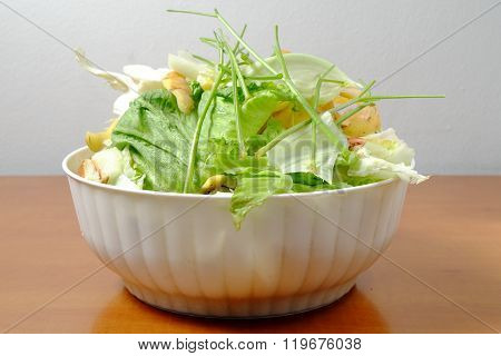 Kitchen Waste Fruit And Vegetable Scraps In A White Plastic Bowl