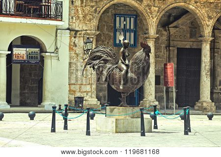 Plaza Vieja, Havana, Cuba. Bronze statue of bald lady astride a cockerel
