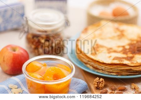 Golden pancakes in a blue plate