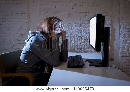 young teenager woman abused suffering internet cyberbullying scared sad and depressed in fear face expression sitting in front of computer monitor in cyber bullying social problem concept
