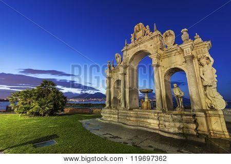 Immacolata Fountain in Naples. Vesuvius in the background. Naples Campania Italy