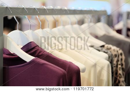 The image of clothes on a hanger in clothes shop