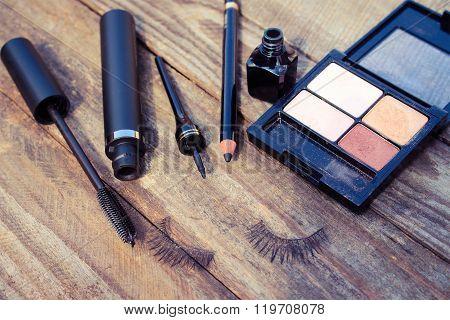 Cosmetics for eyes: pencil, mascara, eyeliner, false eyelashes and eye shadow.