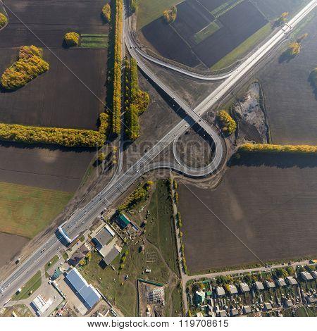 Aerial road interchange, viaduct. Crossroads view parking lots, bridges. Copter shot. Panoramic imag