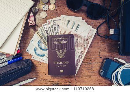 Vintage tone, travel preparation objects on desk, passport, cash, gadget and etc.