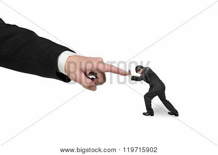 Small Man Pushing Against Big Other Hand Forefinger