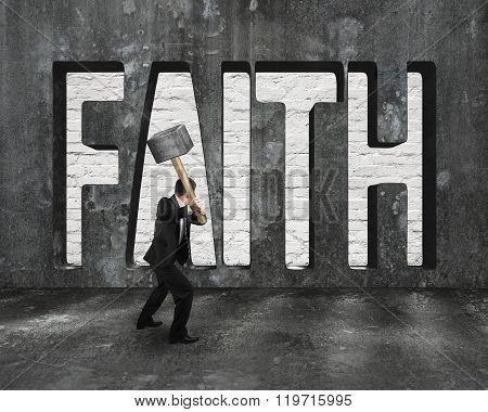 Faith Word On Concrete Wall With Man Holding Hammer