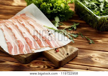 Crispy Strips Of Bacon On A Brown Wooden Background