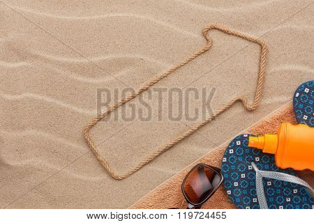 Pointer Made Of Rope On The Sand  With Place For Your Text