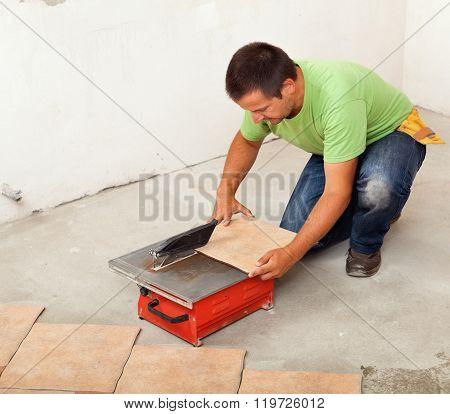 Man Cutting Ceramic Floor Tile