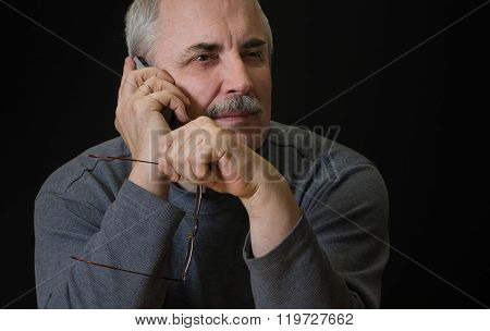 Caucasian man listening cellular phone