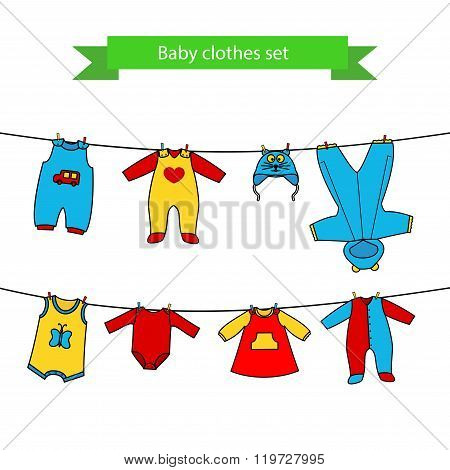 Set of cute clothess for the little baby on the clothesline.