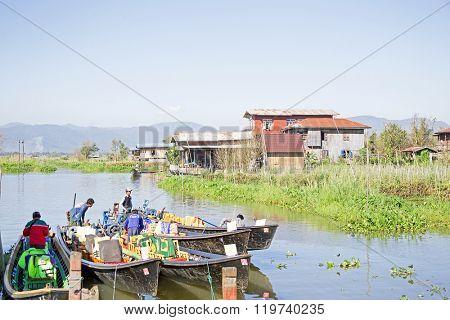 INLE LAKE, MYANMAR - NOVEMBER 23, 2015: Local sellers with their goods on Inle Lake, Myanmar on the 23th November, 2015.