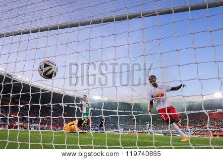 VIENNA, AUSTRIA - SEPTEMBER 28, 2014: Alan (#27 Salzburg) scores a goal in an Austrian soccer league game.