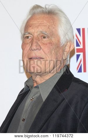 LOS ANGELES - FEB 26:  George Lazenby at the The Film is GREAT Reception Honoring British 2016 Oscar Nominees at the Fig and Olive on February 26, 2016 in West Hollywood, CA