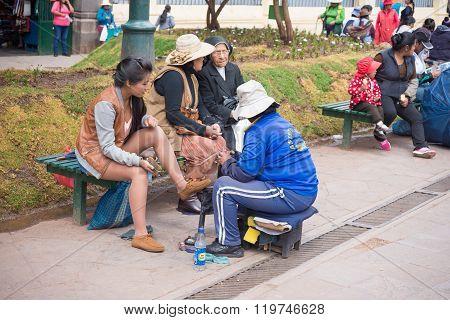 Shoeshiner Working In Cusco Street, Peru