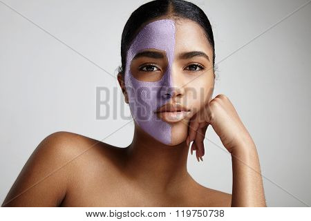 Woman With A Half Of A Face With Facial Mask