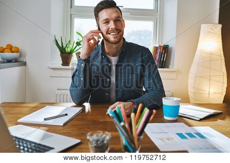 Smiling Man Working At Desk Office
