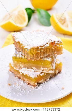 Lemon Pie Sliced On White Plate