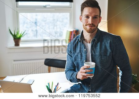 Young Entrepreneur Sitting In His Office