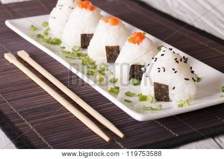 Japanese Onigiri Stuffed With Salmon And Sesame Close-up. Horizontal
