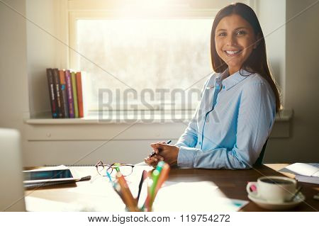 Successful Business Woman Sitting At Her Desk