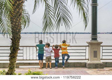 Boys Watching The River At Puerto Santa Ana In Guayaquil Ecuador