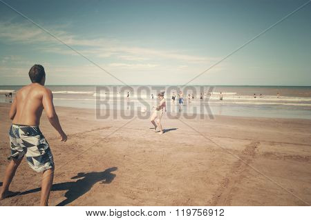 Couple  playing ball in a beach