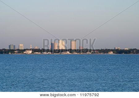 A photo of the Tampa Skyline viewed from across the water of Tampa Bay.